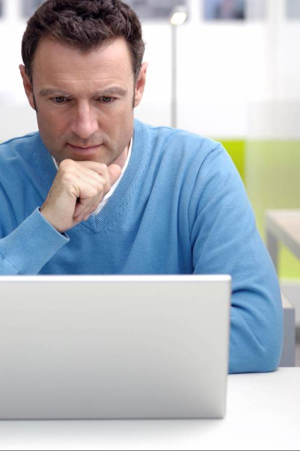 Concerned Man on Laptop