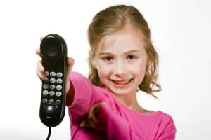 little girl handing over phone