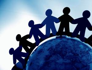 holding hands around globe
